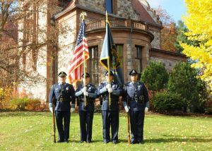 4 members of the Honor Guard in front of a large building