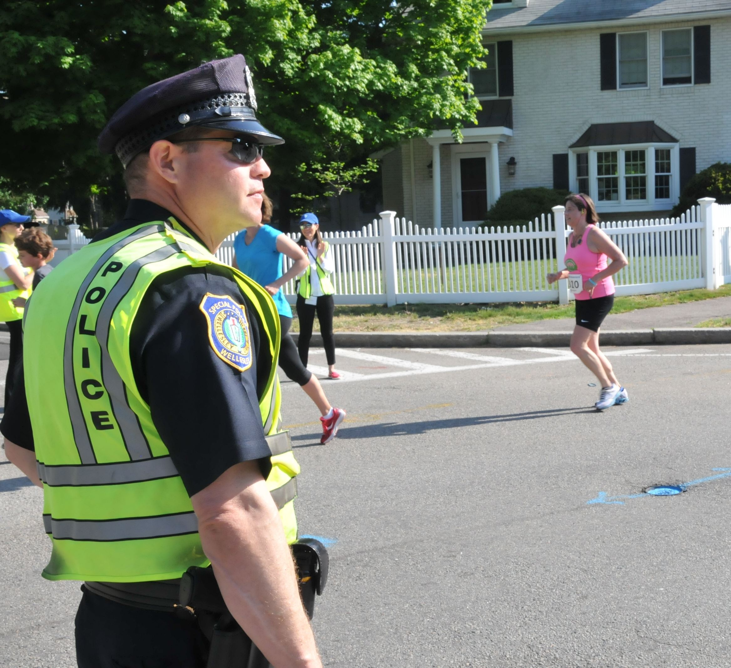 Special Police Officer helping with a running event