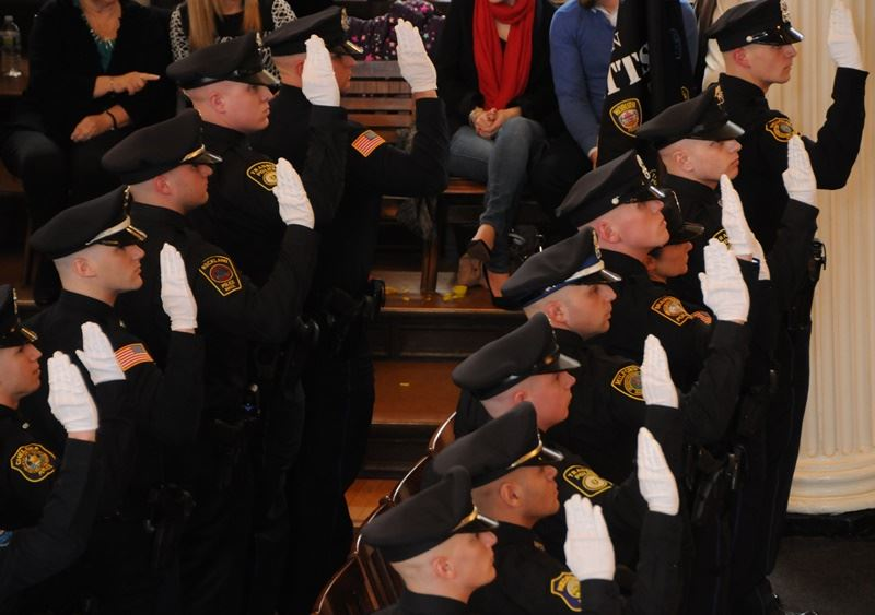 Police officers being sworn into office